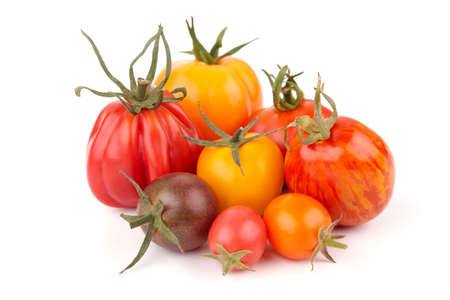 cherry varieties: Group of different exotic tomatoes on white background. Stock Photo