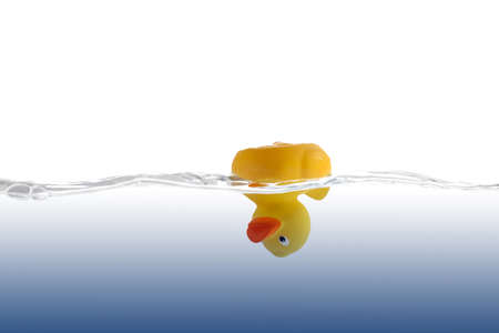 rubber ducky: Yellow Rubber Duck, head-down in blue water.