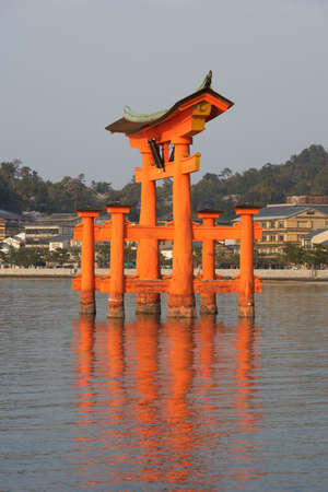 Side view on the blazing Miyajima Torii at sunset. Stock Photo - 5768836
