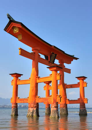 Miyajima Torii, belonging to Itsukushima Shrine on Miyajima/Japan at low tide. Stock Photo - 5768829