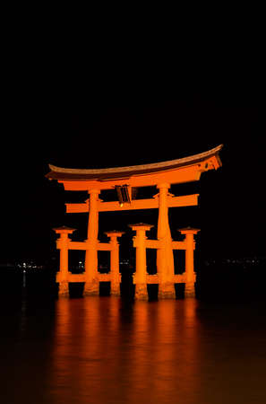 Blazing Miyajima Torii at night with a nice soft refection on water. Stock Photo - 5768868