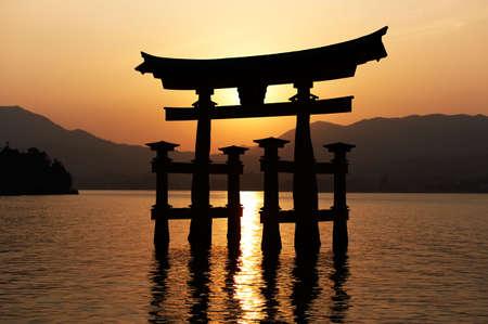 Miyajima gate silhouette at sunset.  Stock Photo - 5768871