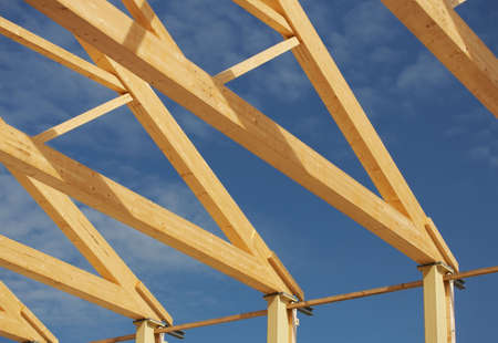 New warehouse during the framing stage with a blue sky background. Stock Photo