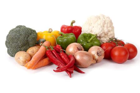 Fresh tasty vegetables, arranged over white background.