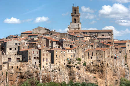 Panoramic view on a typical small medieval tuscany village with bell tower. photo