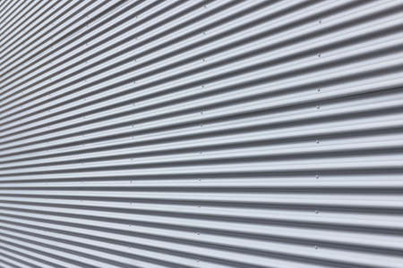 Nice corrugated aluminium wall with diminishing perspective. Stock Photo