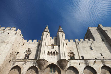 14th century: Front view with centered towers from Palais of the Popes in Avignon - France.
