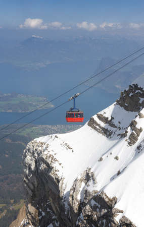 View over Lake Lucerne from Mount Pilatus (Switzerland). In the background famous Lake Lucerne and the Swiss Alps. photo