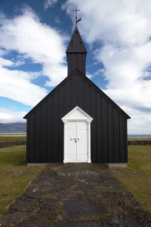 Front view of the famous black church in Budir, Western Iceland. Stock Photo