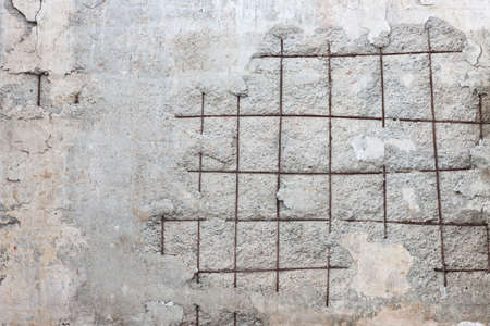 Run Down Concrete Wall With Visible Armoring Iron photo