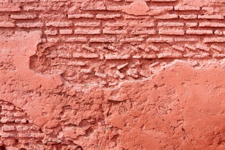 Moroccan Red Brick Wall with hand made brickwork. Seen in the old town (medina) of Marrakesh. photo