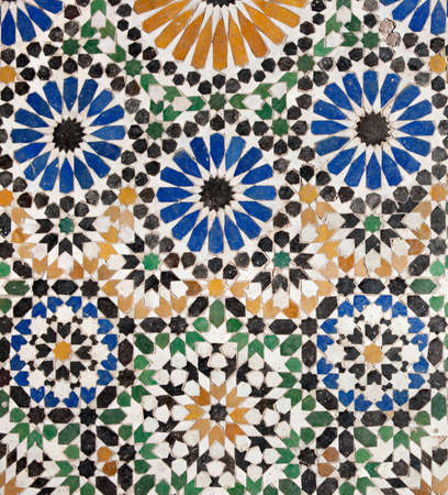 Detail of a traditional islamic mosaic in Marrakesh, well run down but still showing nice details. photo