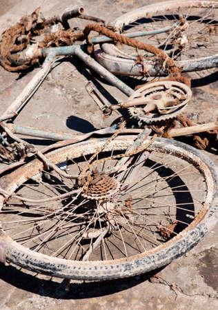 Abandoned rusty bike, lying waysides. photo