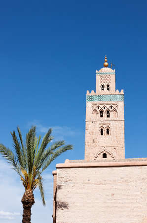 Koutoubia Mosque with its beautiful decorated minaret, Marrakech Morocco. photo