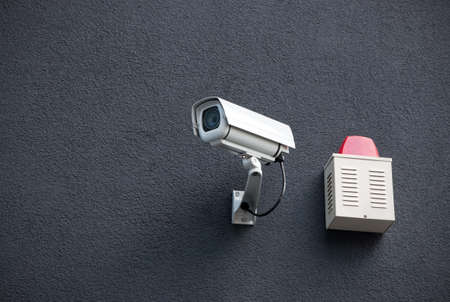 security equipment: Security camera system on a dark gray concrete wall. Stock Photo