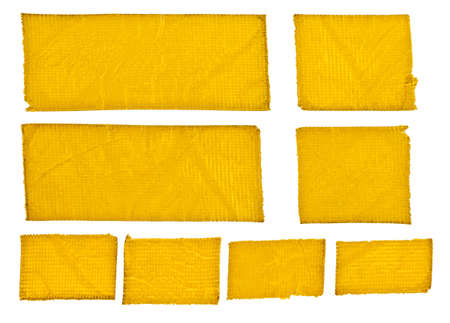 Strong yellow tape stripes with textured surface. Different sizes, all used and well isolated on white. photo