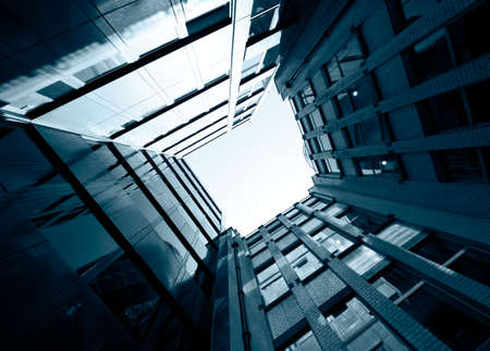 Low Angle View of surrounding buildings against the sky. Stock Photo - 10412298
