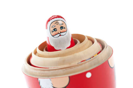 The smallest of a Santa Claus inside the layers of a russian nesting doll. photo