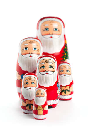 matroshka: Santa Claus nesting doll family with focus on the middle one, isolated on white.