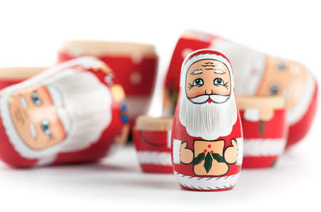 unpacked: Unpacked small Christmas Nesting Doll, isolated on white. Stock Photo