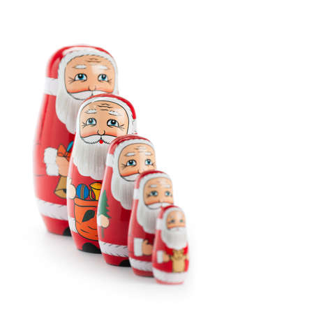 babushka: Happy Santa Claus family with selective focus. Isolated on white.