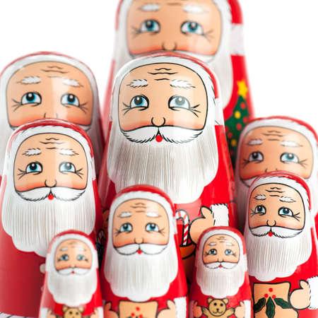 matroshka: Santa Claus family portrait with selective focus, isolated over white. Stock Photo