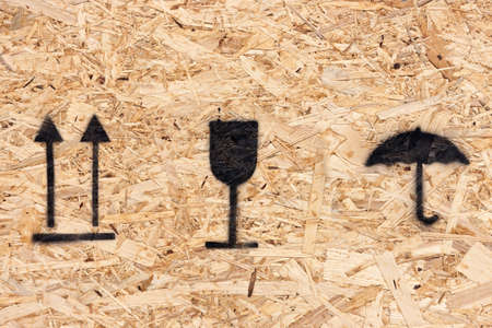 Shipping icons on a chipboard container. Handle with care. Stock Photo - 12476728
