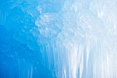 Deep blue Swiss Mountains icicles formation.