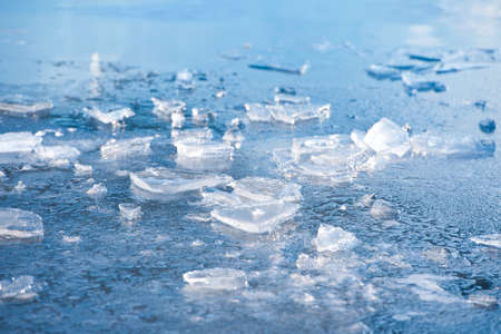 arctic waters: Frozen mountain lake surface with blocks. Stock Photo
