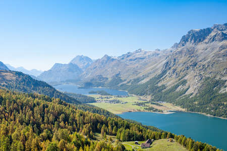 Aerial view on the Corvatsch hiking resort with Lake Silvaplana and Lake Sils, near St Moritz  Stock Photo