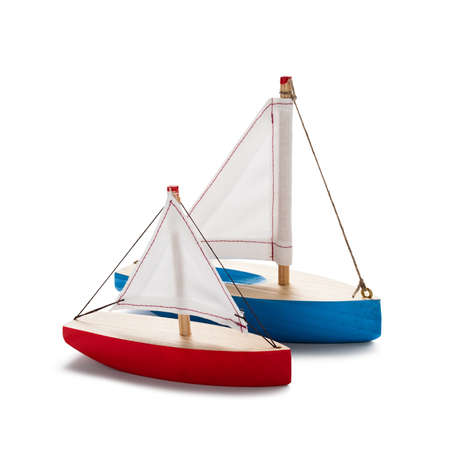 yacht isolated: Red and blue toy sailboats, isolated on white.