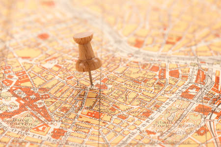 Wooden pin on an old city map of Vienna. Stock Photo
