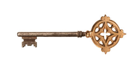 Golden skeleton key, isolated on white  Clipping path included  photo
