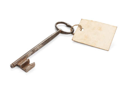 Old key with worn blank message label, isolated on white  Stock Photo - 17930543