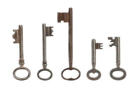 Collection of five assorted keys, isolated on white  Clipping path included  photo