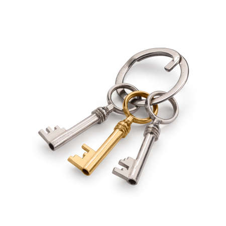 Bunch of three old keys, with a golden one. Isolated on white with clipping path and soft shadows. photo