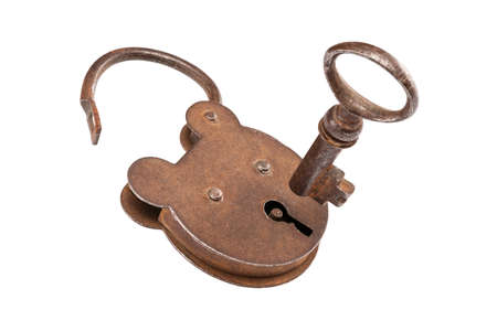 Antique padlock with pending key, isolated on white. photo