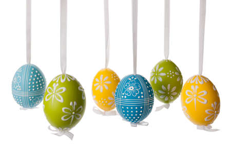 Easter egg decoration, hanging over isolated white background. photo