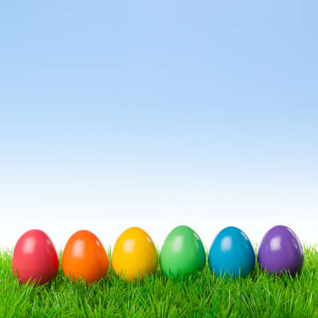 egg hunt: Colorful easter eggs on a fresh meadow, isolated over a bright spring sky.
