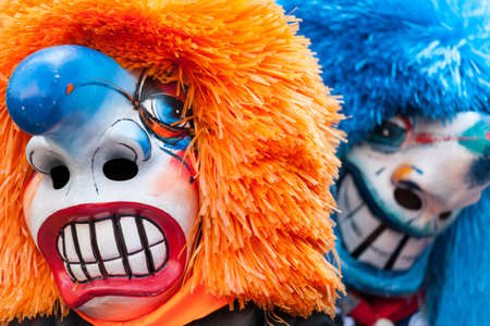fasnacht: Two traditional waggis masks with orange and blue hair at fasnacht festival Basel, Switzerland  Editorial
