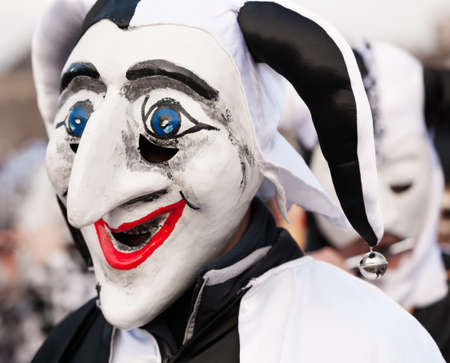 Black and white jester mask at fasnacht carnival in Basel, Switzerland