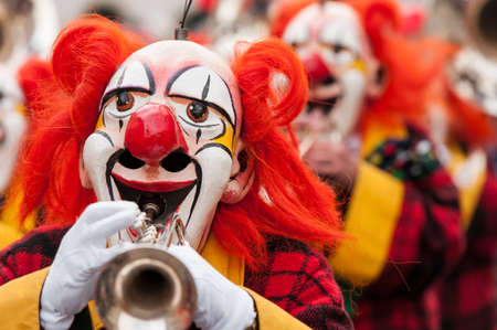 fasnacht: Colorful clown group playing the trumpet at Basel fasnacht festival