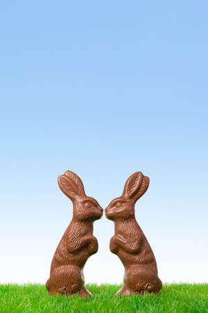 Cheerful chocolate easter bunnies in love  photo