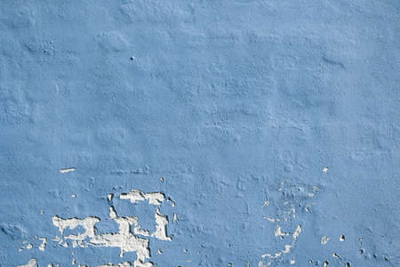 Blue painted brick wall with blue weathered plaster  photo