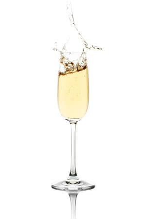 new year  s day: Sparkling champagne, spashing out the crystal flute