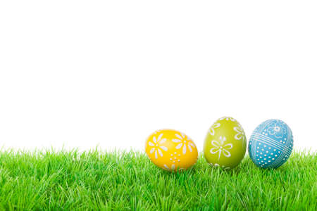 Colorful easter eggs on meadow over white background  Stock Photo