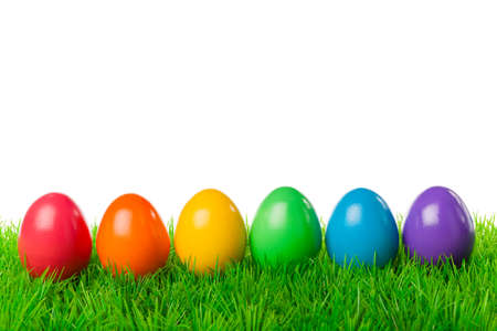 Colorful easter eggs on a fresh meadow, isolated on white  photo
