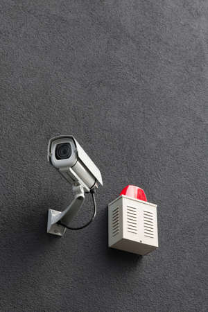 White security camera system on a wall  Stock Photo