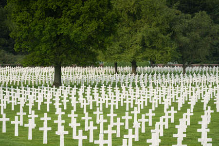 military cemetery: White crosses filling the fresh green lawn at Henri-Chapelle, one of the largest US War Cemeteries in Europe.