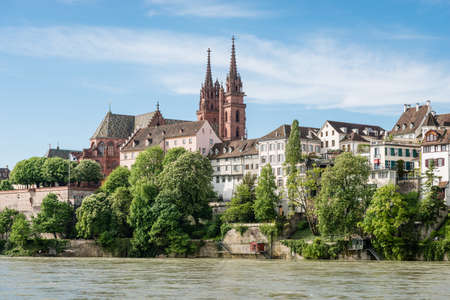 water's edge: View up to the cityscape of Basel with its famous red sandstone cathedral.